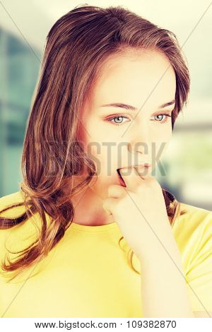 Woman putting her finger in mouth to provoke vomiting