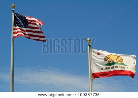 THe US Stars & Stripes, old glory and the California Republic flags waving in a stiff breeze