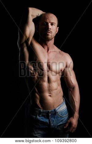 Handsome man with muscular body looking at camera