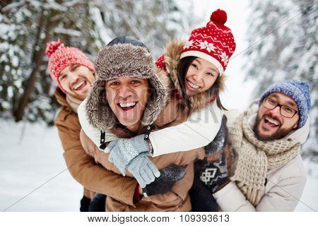 Ecstatic friends having fun in winter park