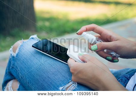 Woman In Blue Jeans Cleans Mobile Phone Antibacterial Wipes