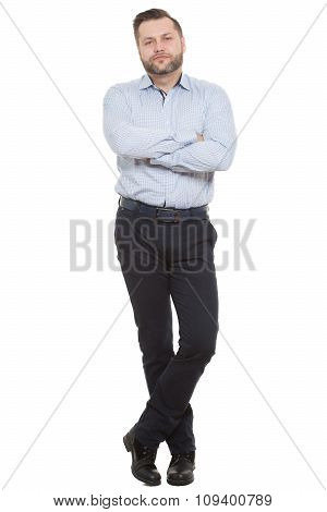 adult male with a beard. isolated on white background. Closed posture. arms and legs crossed. body l