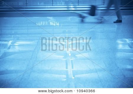 business people walking fast in the airport
