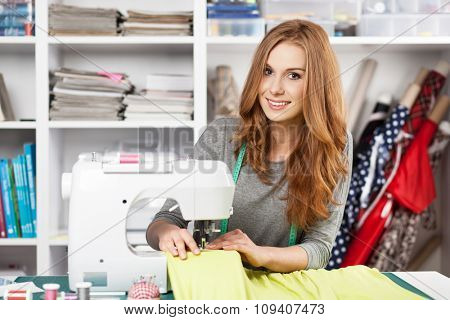 Young woman working with a sewing machine