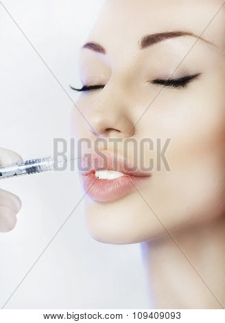 Woman Geting An Injection In Her Lips In Beauty Salon