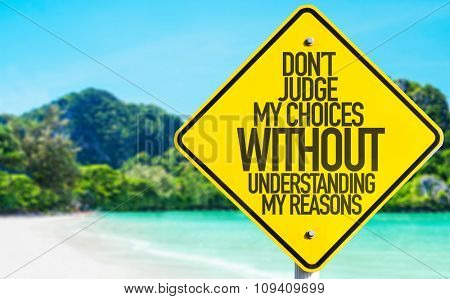 Don't Judge My Choices Without Understanding My Reasons sign with beach background