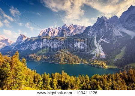 Fantastic alpine lake Vorderer Gosausee. Picturesque scene. Salzkammergut is a famous resort area located in the Gosau Valley in Upper Austria. Gosaukamm range and Dachstein glacier. Beauty world.