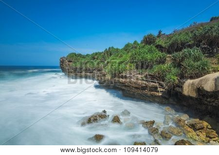 Beautiful blue sky view over seascape of Pantai Banyu Tibo, Indonesia