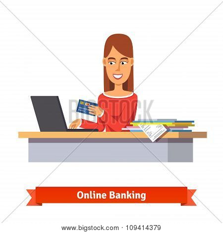 Bank clerk at the table issuing a credit card