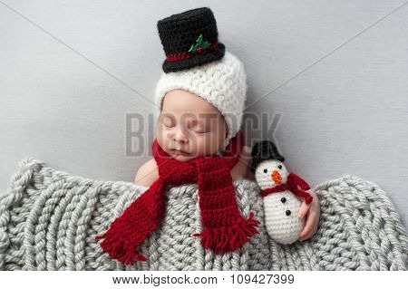 Newborn Baby Boy With Snowman Hat And Plush Toy