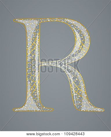 Abstract golden letter R.