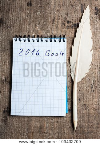 Notebook with pen and goals of year 2016