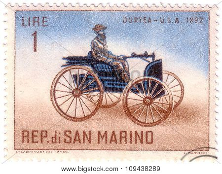 San Marino - Circa 1962: A Stamp Printed In San Marino Shows Old Auto With The Inscription