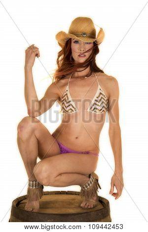 Red Head Woman In Bikini On Barrel Look Serious Cowgirl