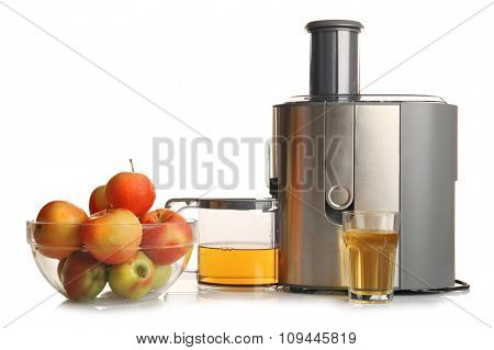 Stainless juice extractor with apples isolated on white background