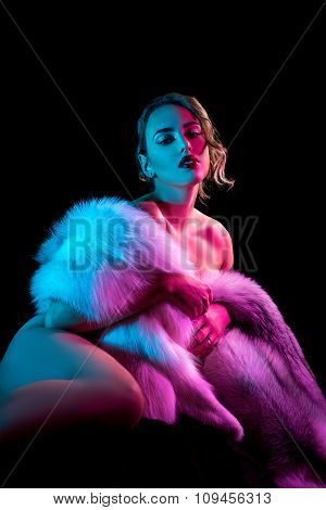 Elegant girl covers her nakedness with chic coat
