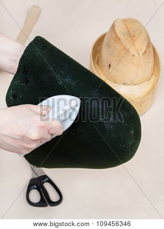 Hatter Gluing A Felt Hood For Shaping On Dummy