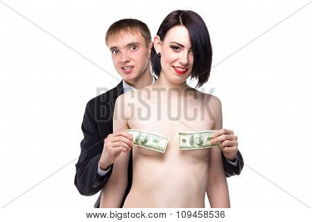 Woman and man cover her small breast with dollars