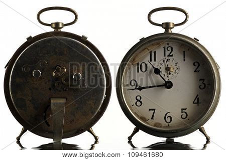 back and front of an old alarm clock
