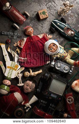 old, broken toys on the floor