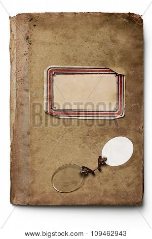 rimless glasses on an isolated old notebook