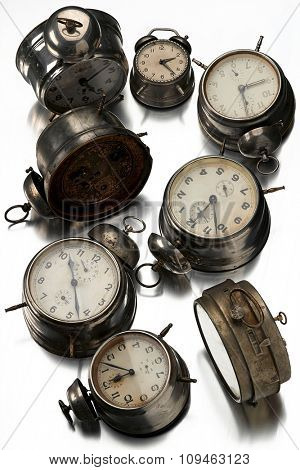 vintage alarm clocks on white