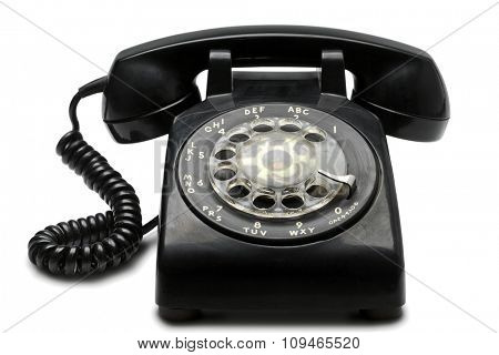 an old black rotary phone on white with clipping path