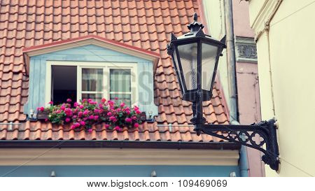 Vintage Street Lamp On Wall And Window In Garret Roof On Background. Selective Focus.