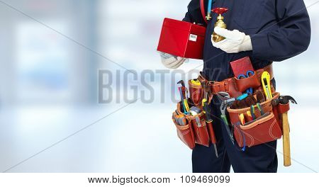 Plumber hands with water tap over blue banner background.