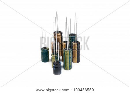 Electrolytic Capacitors Green,black,yellow Isolated On White