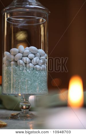 table decoration with stone candies and candle