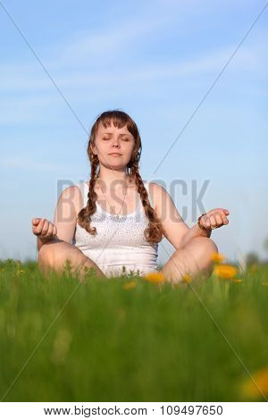 The Girl Meditates In Nature