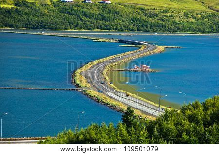 Road accross fjord near city of Akureyri