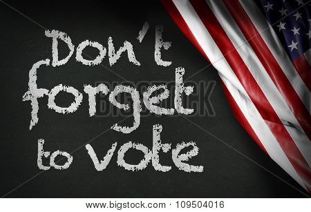 Don't forget to vote written on blackboard and the USA flag