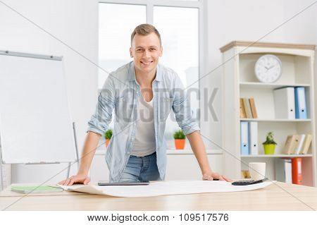 Male office worker is busy at the office.