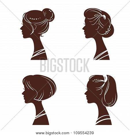 Four silhouettes of women's heads with beautiful stylized haircut