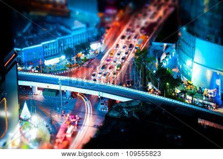 Tilt Shift. Futuristic Night Cityscape. Bangkok, Thailand