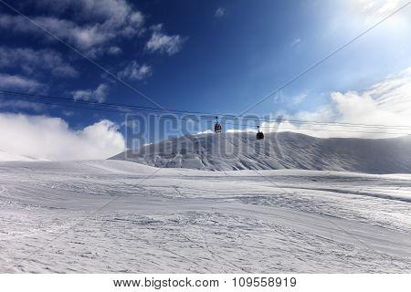 Gondola lift and ski at sun day. Georgia ski resort Gudauri. Caucasus Mountains. Wide angle view. poster