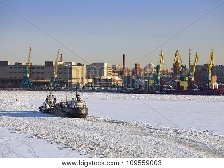 Operation of the auxiliary ships in seaport of St. Petersburg during winter navigation. Russia.