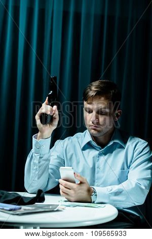 Stalker With Gun And Phone