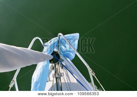 Prow High View Of Sailboat Sailing Across Alange Reservoir, Spain