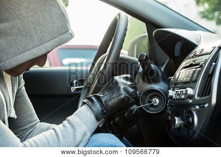Thief Using Tool In Car