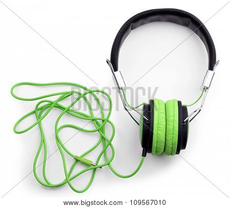 A pair of green-black headphones, isolated on white