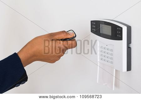 Person's Hand Operating Entrance Security System With Remote