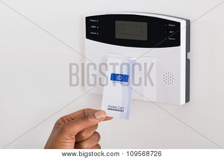 Person's Hand Holding Keycard To Open Door
