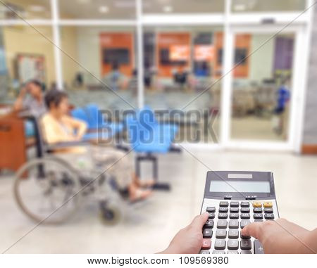 Medical Expense Concept By The Calculator With Blur Patient At The Hospital In Background