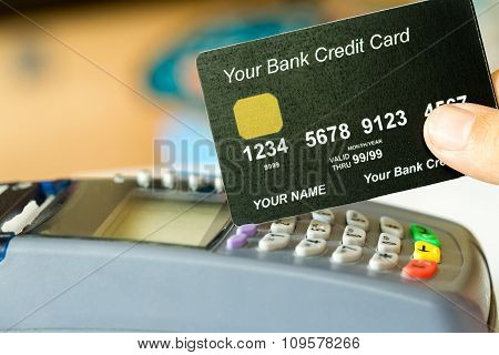 Hand Holding A Credit Card With Credit Card Machine