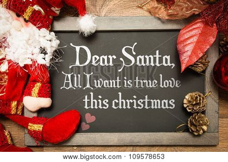 Blackboard with the text: Dear Santa, All I Want is True Love This Christmas