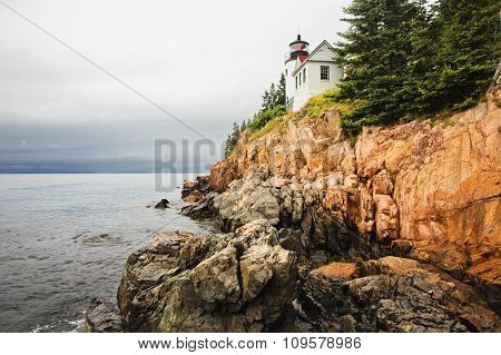 Cliff Side Maine Lighthouse on a Cloudy Day