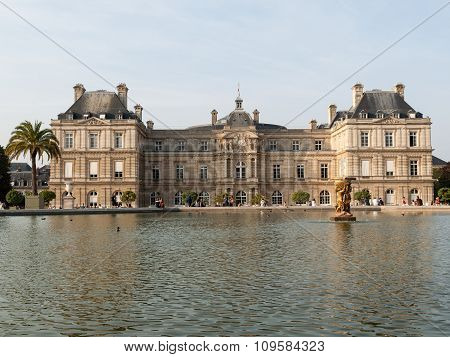 PARIS, FRANCE - SEPTEMBER 8,  2014: People enjoy sunny day in the Luxembourg Garden in Paris. Luxembourg Palace is the official residence of the French Senate.